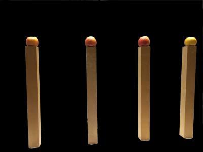 Holz und Apfel als 4 Kerzen
