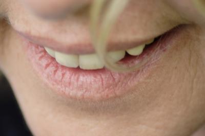 Lächelnder Mund ein Frau